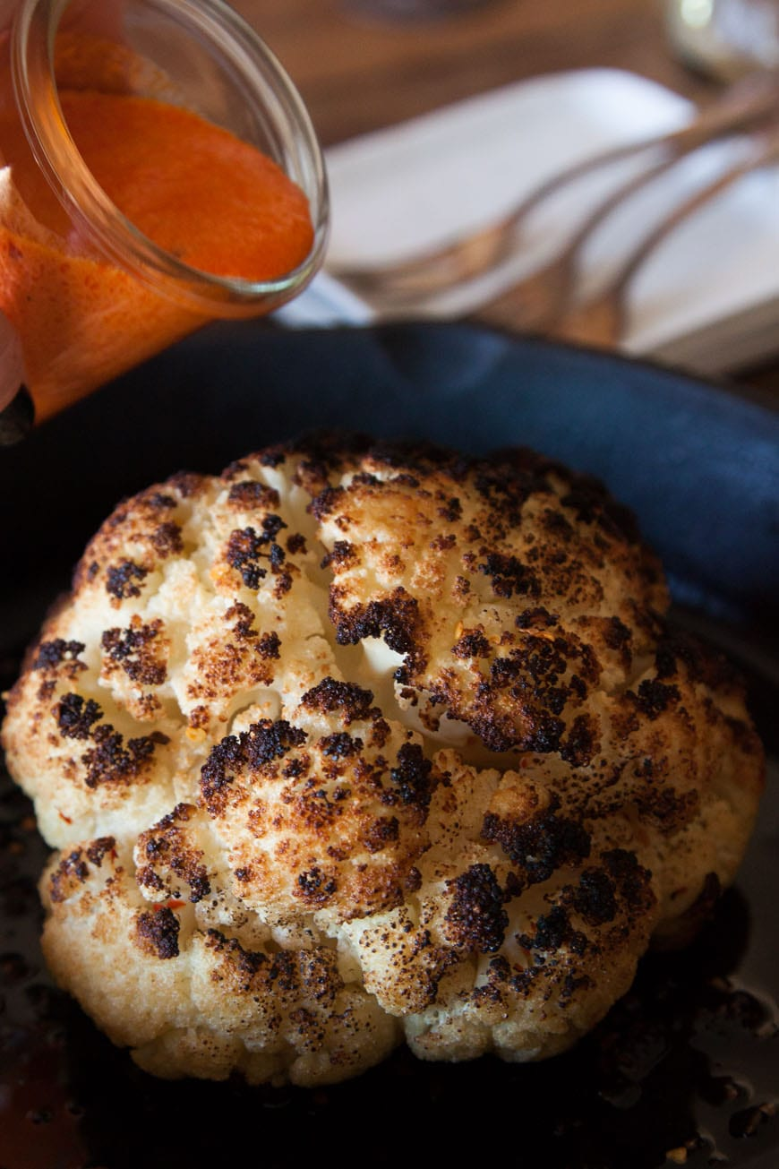 Whole Roasted Cauliflower with Red Pepper Goat Cheese Sauce