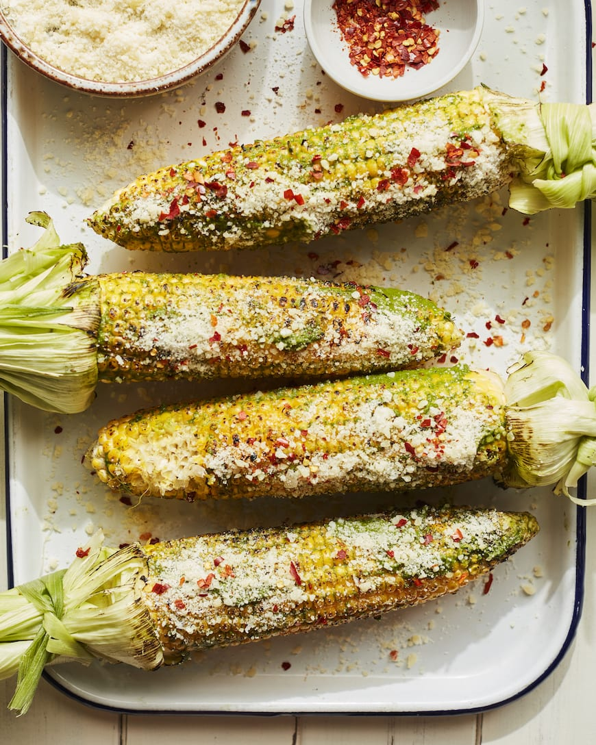 Basil Parmesan Grilled Corn from www.whatsgabycooking.com part of the 20 Easy Weeknight Grilling Recipes (@whatsgabycookin)