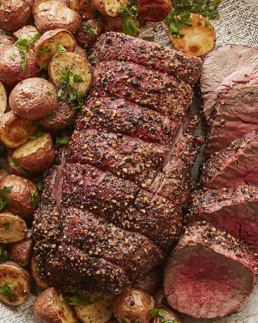 Garlic Peppercorn Crusted Beef Tenderloin from www.whatsgabycooking.com (@whatsgabycookin)